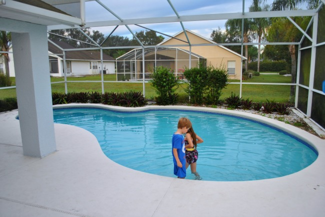 Two children playing in the swimming pool at a villa in Orlando Florida